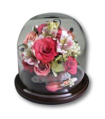 floral cake top preserved in table dome